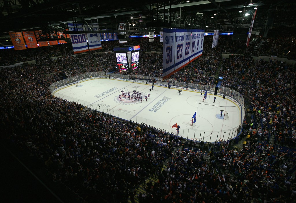 UNIONDALE, NY - APRIL 25:  The New York Islanders celebrate their 3-1 victory over the Washington Capitals in Game Six of the Eastern Conference Quarterfinals during the 2015 NHL Stanley Cup Playoffs at the Nassau Veterans Memorial Coliseum on April 25, 2015 in Uniondale, New York. The Islanders defeated the Capitals 3-1. This could be the final game playe din the arena before the team moves to Brooklyn. (Photo by Bruce Bennett/Getty Images)