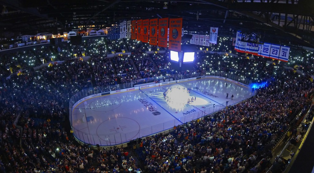 UNIONDALE, NY - OCTOBER 11:  The New York Islanders take part in opening game festivities prior to the game against the Carolina Hurricanes at the Nassau Veterans Memorial Coliseum on October 11, 2014 in Uniondale, New York.  (Photo by Bruce Bennett/Getty Images)