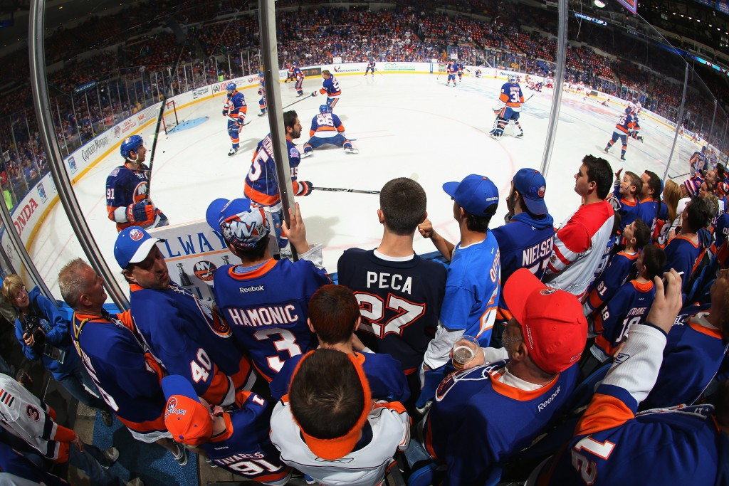 UNIONDALE, NY - APRIL 25:  New York Islanders fans prepare for could be the final game in this building against the Washington Capitals in Game Six of the Eastern Conference Quarterfinals during the 2015 NHL Stanley Cup Playoffs at the Nassau Veterans Memorial Coliseum on April 25, 2015 in Uniondale, New York.  (Photo by Bruce Bennett/Getty Images)