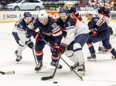 OSTRAVA, CZECH REPUBLIC - MAY 12:  Anders Lee (L) of United States and Adam Janosik (R) of Slovakia battle for the puck during the IIHF World Championship group B match between United States and Slovakia at CEZ Arena on May 12, 2015 in Ostrava, Czech Republic.  (Photo by Matej Divizna/Getty Images)