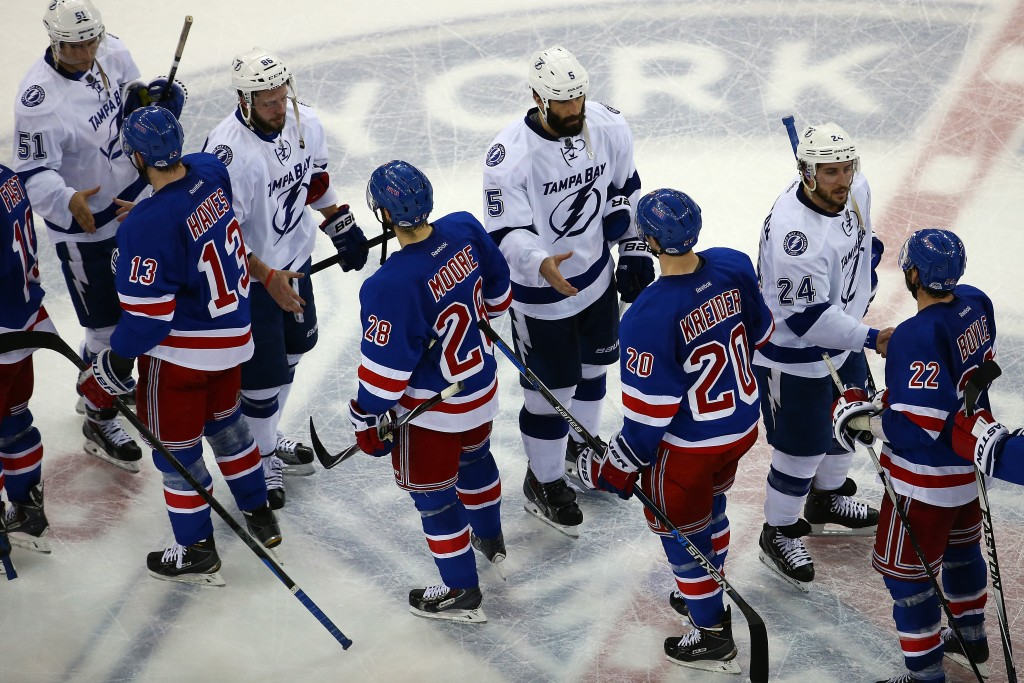 NEW YORK, NY - MAY 29:  The New York Rangers shake hands with the Tampa Bay Lightning after the Lighting defeated the Ranges by a score of 2-0 in Game Seven of the Eastern Conference Finals during the 2015 NHL Stanley Cup Playoffs at Madison Square Garden on May 29, 2015 in New York City.  (Photo by Elsa/Getty Images)