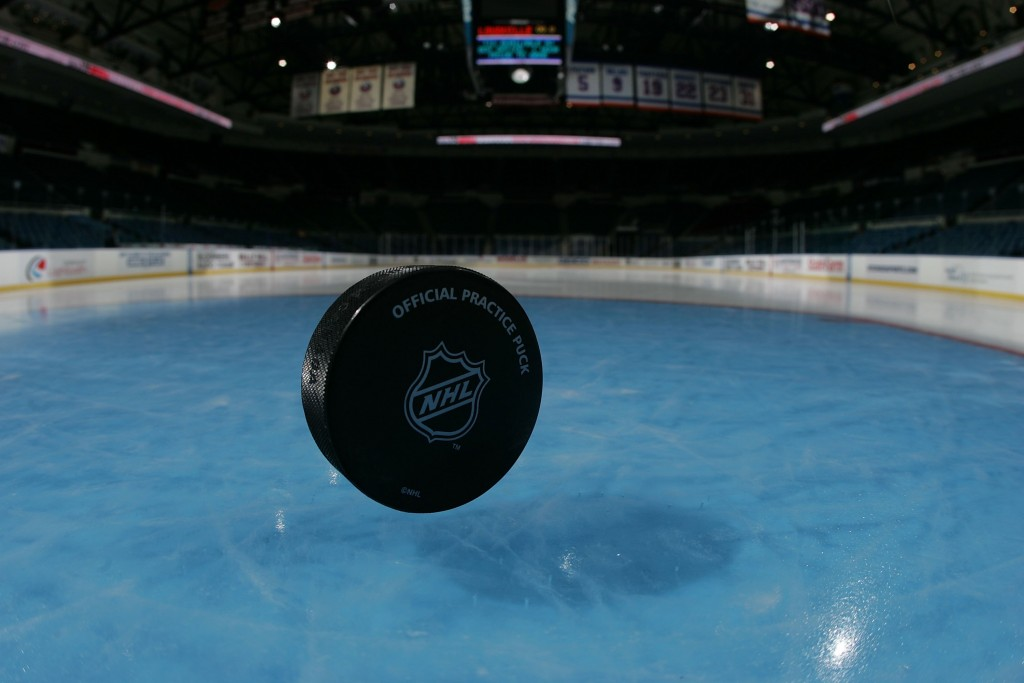 UNIONDALE, NY - MARCH 18: A hockey puck on the ice photographed on March 18, 2008 prior to the game between the Toronto Maple Leafs and the New York Islanders at the Nassau Coliseum in Uniondale, New York. (Photo by Bruce Bennett/Getty Images)