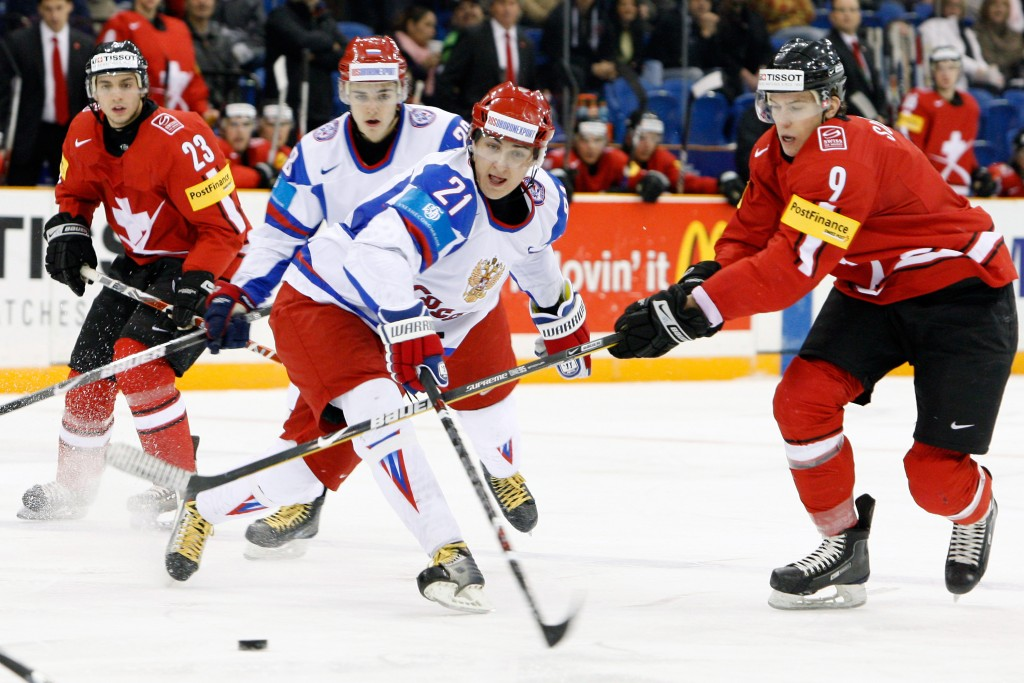 SASKATOON, SK - JANUARY 2:  Kirill Petrov #21 of Team Russia and Reto Schappi #9 of Team Switzerland battle for the puck during the 2010 IIHF World Junior Championship Tournament game on January 2, 2010 at the Credit Union Centre in Saskatoon, Saskatchewan, Canada.  (Photo by Richard Wolowicz/Getty Images)