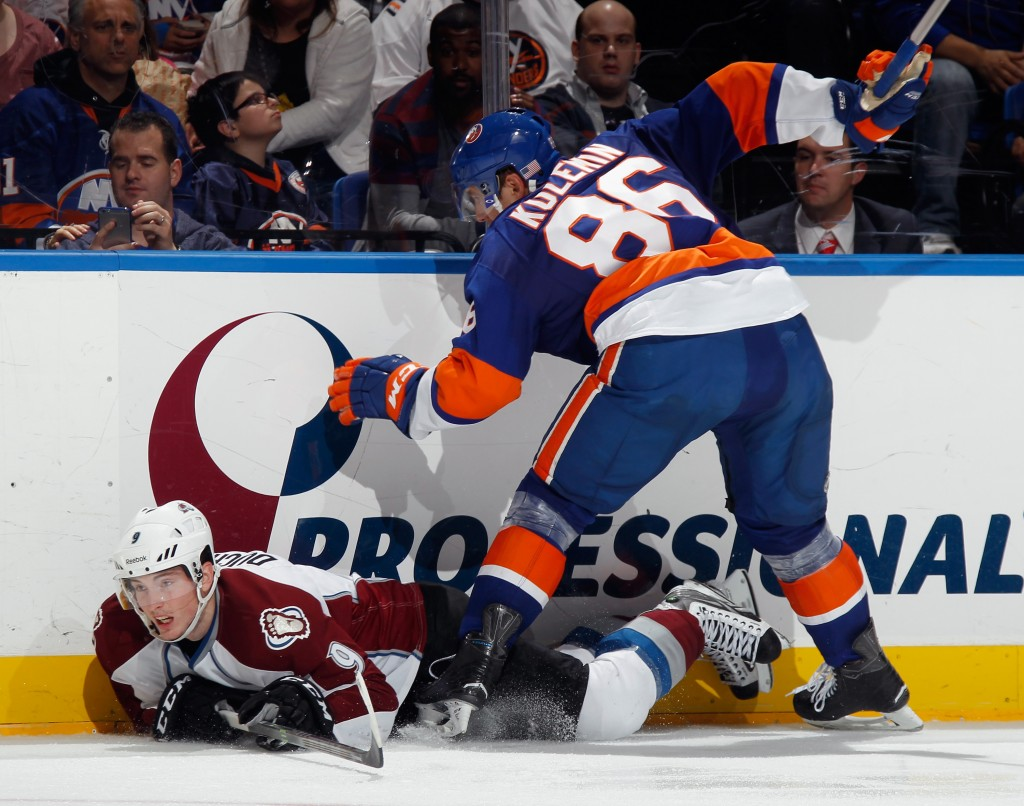 UNIONDALE, NY - NOVEMBER 11: Matt Duchene #9 of the Colorado Avalanche hits the ice as he attempts to get past Nikolai Kulemin #86 of the New York Islanders during the third period at the Nassau Veterans Memorial Coliseum on November 11, 2014 in Uniondale, New York.  The Islanders shutout the Avalanche 6-0. (Photo by Bruce Bennett/Getty Images)