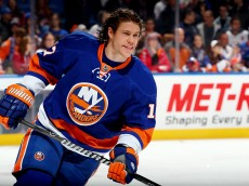 UNIONDALE, NY - DECEMBER 28: Matt Martin #17 of the New York Islanders skates before a game against the New Jersey Devils at the Nassau Veterans Memorial Coliseum on December 28, 2013 in Uniondale, New York.  (Photo by Alex Trautwig/Getty Images)