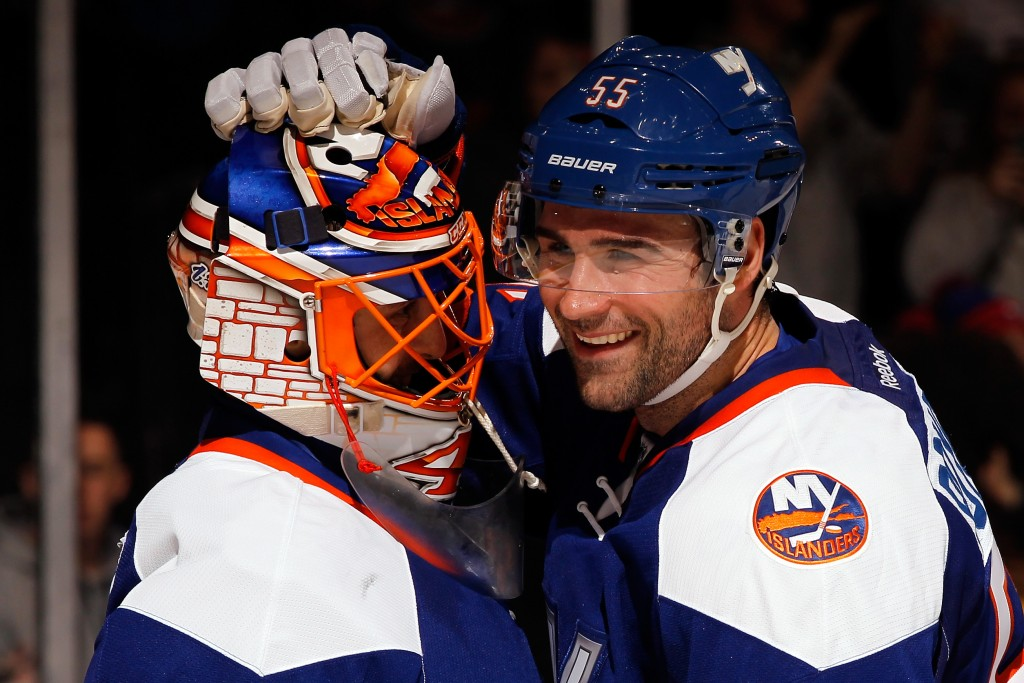 UNIONDALE, NY - DECEMBER 20:  Johnny Boychuk #55 celebrates with Jaroslav Halak #41 of the New York Islanders after defeating the Tampa Bay Lightning 3-1 during a game at the Nassau Veterans Memorial Coliseum on December 20, 2014 in Uniondale, New York.  (Photo by Alex Trautwig/Getty Images)