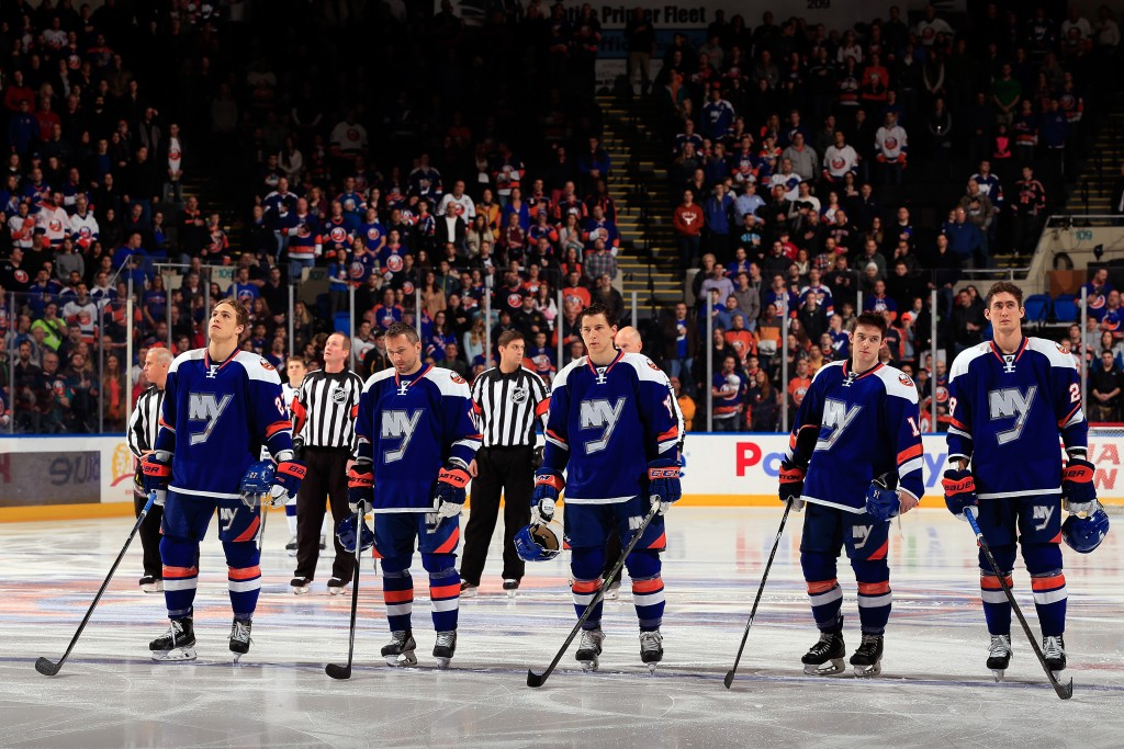 UNIONDALE, NY - DECEMBER 20: The New York Islanders line up during the national anthem prior to a game against the Tampa Bay Lightning at the Nassau Veterans Memorial Coliseum on December 20, 2014 in Uniondale, New York.  (Photo by Alex Trautwig/Getty Images)