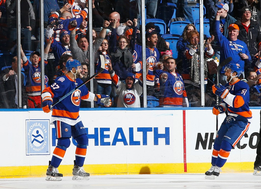 UNIONDALE, NY - FEBRUARY 19:  New York Islanders defenseman Brian Strait #37 celebrates a goal with New York Islanders center Frans Nielsen #51 against the Nashville Predators during their game at the Nassau Veterans Memorial Coliseum on February 19, 2015 in Uniondale, New York.  (Photo by Al Bello/Getty Images)