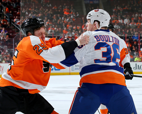 PHILADELPHIA, PA - APRIL 07:  Ryan White #25 of the Philadelphia Flyers and Eric Boulton #36 of the New York Islanders fight in the first period on April 7, 2015 at the Wells Fargo Center in Philadelphia, Pennsylvania.  (Photo by Elsa/Getty Images)