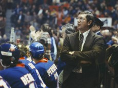 MONTREAL, CANADA - CIRCA 1970:  Head Coach Al Arbour of the New York Islanders follows the action from the bench Circa 1970 at the Montreal Forum in Montreal, Quebec, Canada. (Photo by Denis Brodeur/NHLI via Getty Images)