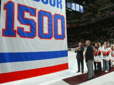 UNIONDALE, NY - NOVEMBER 03:  Former head coach Al Arbour of the New York Islanders watches a banner rise to the rafters honoring his 1,500th game coached with the team after coaching a 3-2 victory against the Pittsburgh Penguins on November 3, 2007 at Nassau Coliseum in Uniondale, New York. (Photo by Jim McIsaac/Getty Images)