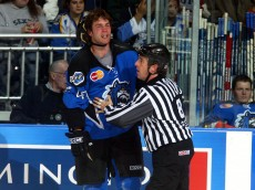 BRIDGEPORT, CT - OCTOBER 16:  A referee restrains Eric Godard #49 of the Bridgeport Sound Tigers during the game against the Albany River Rats on October 16, 2004 at the Arena at Harbor Yard in Bridgeport, Connecticut.  The Sound Tigers defeated the River Rats 4-1.  (Photo by Jim McIsaac/Getty Images)