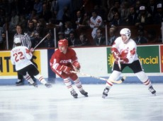 CALGARY, AB - SEPTEMBER 13:  Vladimir Krutov #9 of the Soviet Union defends against Denis Potvin #5 of Canada during the 1984 Canada Cup on September 13, 1984 at the Olympic Saddledome in Calgary, Alberta, Canada.  (Photo by B Bennett/Getty Images)