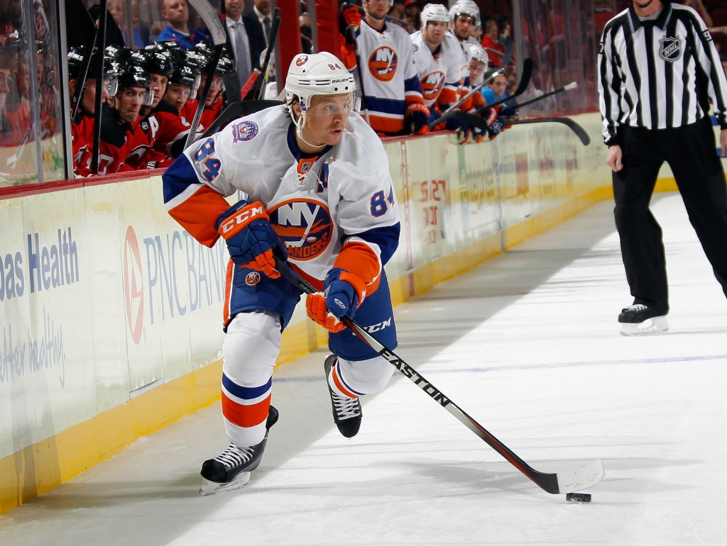 NEWARK, NJ - OCTOBER 02:  Mikhail Grabovski #84 of the New York Islanders skates against the New Jersey Devils at the Prudential Center on October 2, 2014 in Newark, New Jersey. The Devils defeated the Islanders 2-1 in the shootout.  (Photo by Bruce Bennett/Getty Images)