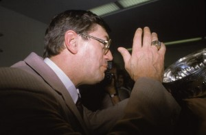 Canadian-born hockey coach and former professional hockey player Al  Arbour, head coach of the New York Islanders, drinks champagne out of the Stanley Cup after the Islanders swept the Edmonton Oilers in four games to win their fourth consecutive final, Nassau Coliseum, Uniondale, Long Island, New York, May 17, 1983. It was also Arbour's fourth straight championship as the head coach of the Islanders, and he wears one of his championship rings. (Photo by Bruce Bennett Studios/Getty Images)