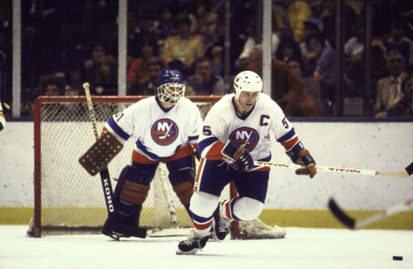Hockey: NHL Finals: New York Islanders Denis Potvin (55) in action vs Minnesota North Stars. View of Islanders goalie Billy Smith (31) in background. Game 1. Uniondale, NY 5/12/1981 CREDIT: Manny Millan (Photo by Manny Millan /Sports Illustrated/Getty Images) (Set Number: X25602 )