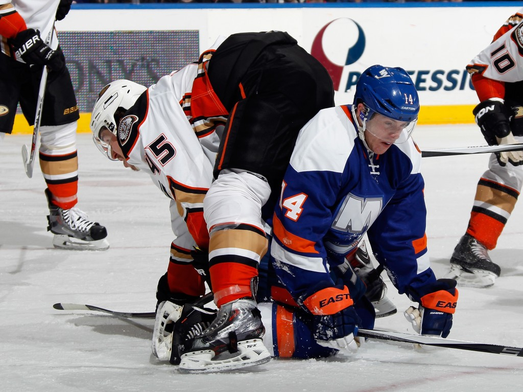 UNIONDALE, NY - MARCH 28: Thomas Hickey #14 of the New York Islanders is checked by Sami Vatanen #45 of the Anaheim Ducks during the second period at the Nassau Veterans Memorial Coliseum on March 28, 2015 in Uniondale, New York.  (Photo by Bruce Bennett/Getty Images)