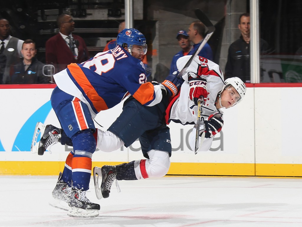 NEW YORK, NY - SEPTEMBER 28: Marek Zidlicky#28 of the New York Islanders checks Andre Burakovsky #65 of the Washington Capitals during the first period at the Barclays Center on September 28, 2015 in Brooklyn borough of New York City.  (Photo by Bruce Bennett/Getty Images)