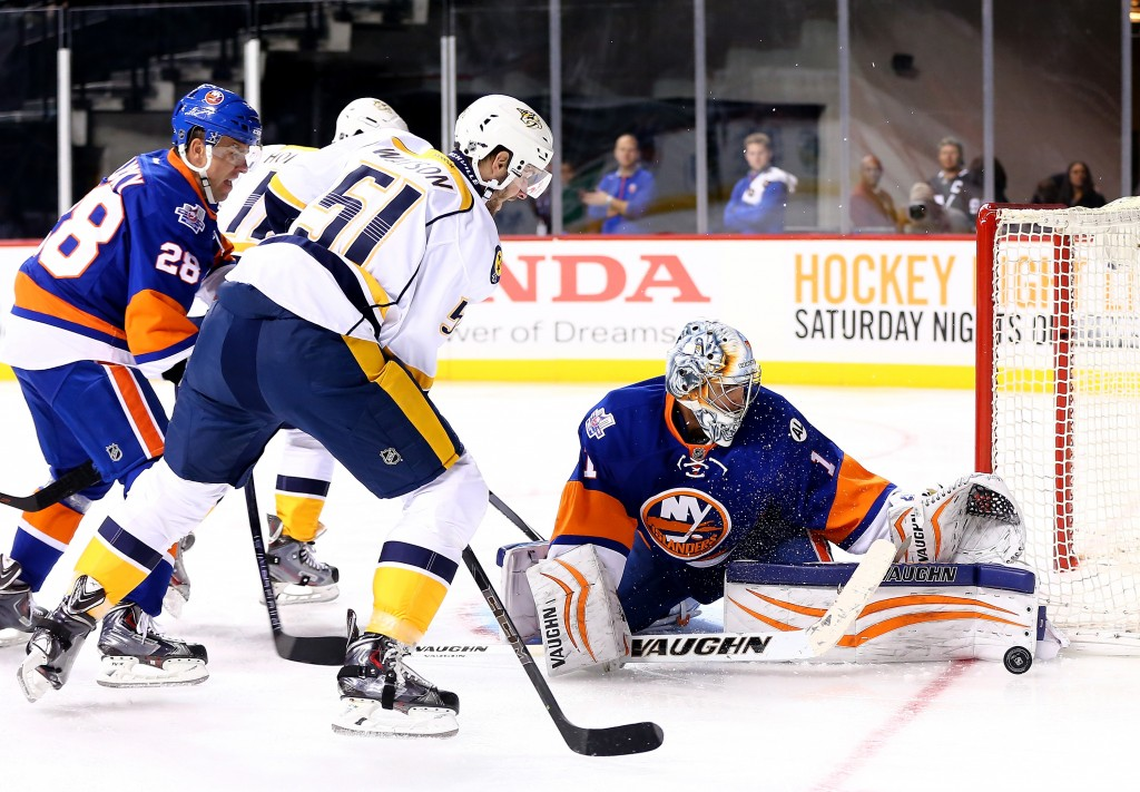 NEW YORK, NY - OCTOBER 15:  Austin  Watson #51 of the Nashville Predators tries to get a shot past Thomas  Greiss #1 of the New York Islanders in the first period at the Barclays Center on October 15, 2015 in the Brooklyn borough of New York City.  (Photo by Elsa/Getty Images)