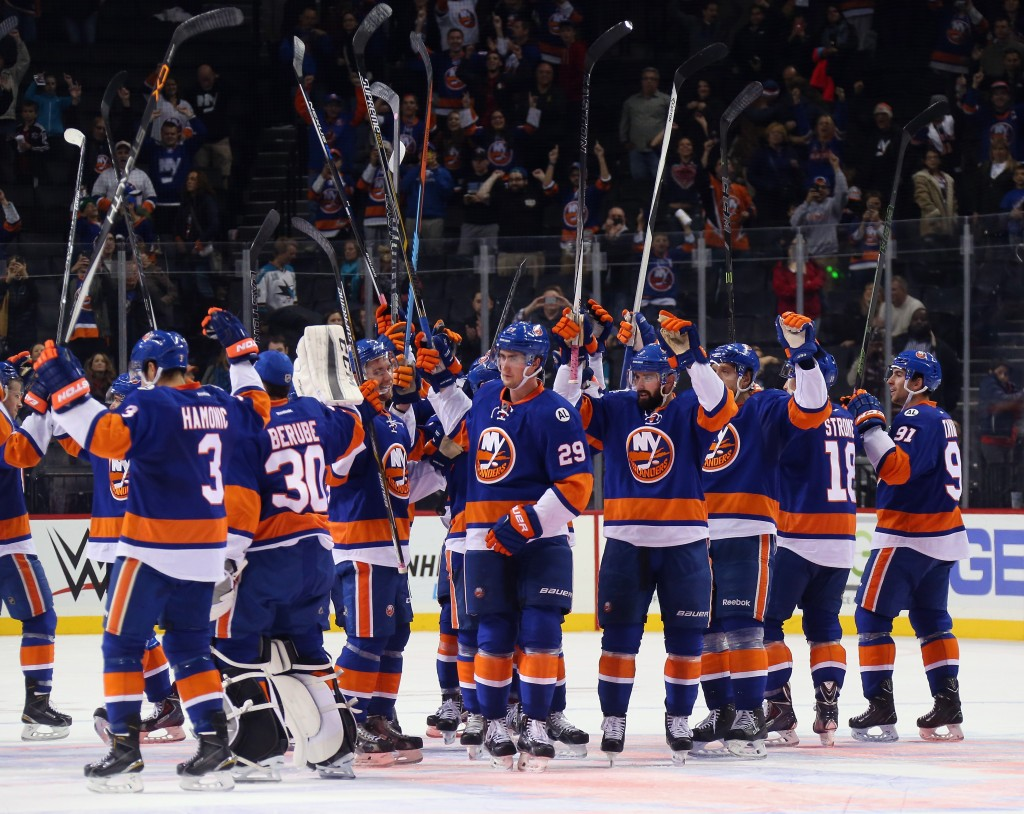NEW YORK, NY - OCTOBER 17:  The New York Islanders celebrate their 6-3 victory over the San Jose Sharks at the Barclays Center on October 17, 2015 in the Brooklyn borough of New York City.  (Photo by Bruce Bennett/Getty Images)