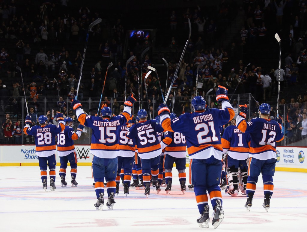 NEW YORK, NY - OCTOBER 26: The New York Islanders celebrate their win against the Calgary Flames at the Barclays Center on October 26, 2015 in the Brooklyn borough of New York City. The Islanders shut out the Flames 4-0.  (Photo by Bruce Bennett/Getty Images)