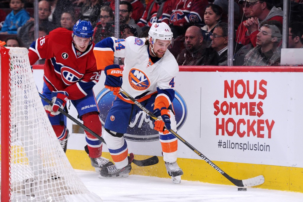 MONTREAL, QC - JANUARY 17: Calvin de Haan #44 of the New York Islanders stick handle the puck during the NHL game against the Montreal Canadiens at the Bell Centre on January 17, 2015 in Montreal, Quebec, Canada.  The Canadiens defeated the Islanders 6-4.  (Photo by Richard Wolowicz/Getty Images)