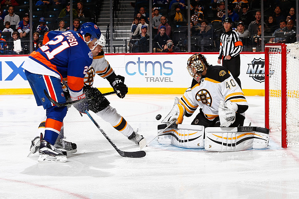 NEW YORK, NY - NOVEMBER 08: Tuukka Rask #40 of the Boston Bruins makes a save on Kyle Okposo #21 of the New York Islanders during the game at the Barclays Center on November 8, 2015 in Brooklyn borough of New York City.  The Bruins defeated the Islanders 2-1. (Photo by Mike Stobe/NHLI via Getty Images)