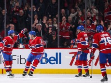 MONTREAL, QC - NOVEMBER 22: David Desharnais #51 and Dale Weise #22 of the Montreal Canadiens celebrate a goal in the NHL game against the New York Islanders at the Bell Centre on November 22, 2015 in Montreal, Quebec, Canada. (Photo by Francois Lacasse/NHLI via Getty Images)