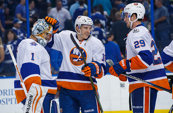 TAMPA, FL - NOVEMBER 28:  Ryan Strome #18 of the New York Islanders congratulates goalie Thomas Greiss #1 after defeating the Tampa Bay Lightning 3-2 at Amalie Arena on November 28, 2015 in Tampa, Florida.  (Photo by Scott Audette/NHLI via Getty Images)