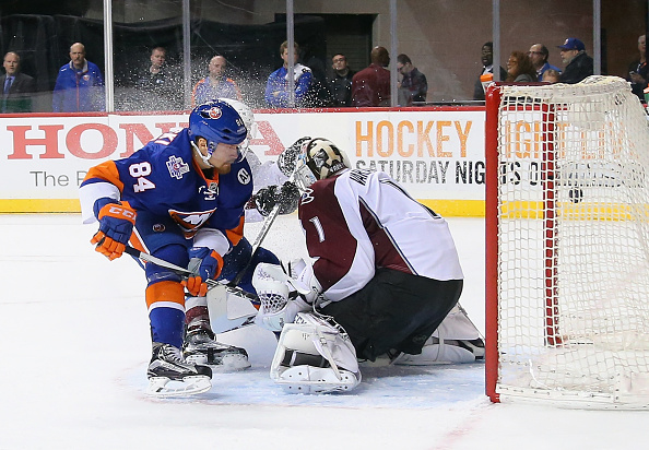 NEW YORK, NY - NOVEMBER 30: Mikhail Grabovski #84 of the New York Islanders scores a second period goal against Semyon Varlamov #1 of the Colorado Avalanche at the Barclays Center on November 30, 2015 in the Brooklyn borough of New York City.  (Photo by Bruce Bennett/Getty Images)