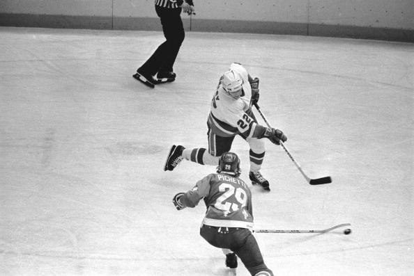 Canadian ice hockey player Mike Bossy (center) of the New York Islanders on the ice during a game against the Quebec Nordiques at Nassau Coliseum, Uniondale, New York, January 24, 1981. Later in the game, Bossy scored his 50th goal in 50 consecutive games. (Photo by Bruce Bennett Studios/Getty Images)
