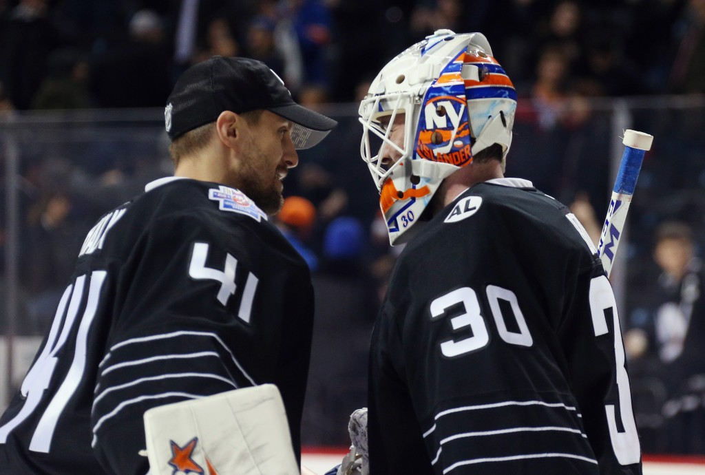 NEW YORK, NY - FEBRUARY 02:  Jaroslav Halak #41 and Jean-Francois Berube #30 of the New York Islanders celebrate Berube's 5-3 victory over the Minnesota Wild at the Barclays Center on February 2, 2016 in the Brooklyn borough of New York City.  (Photo by Bruce Bennett/Getty Images)