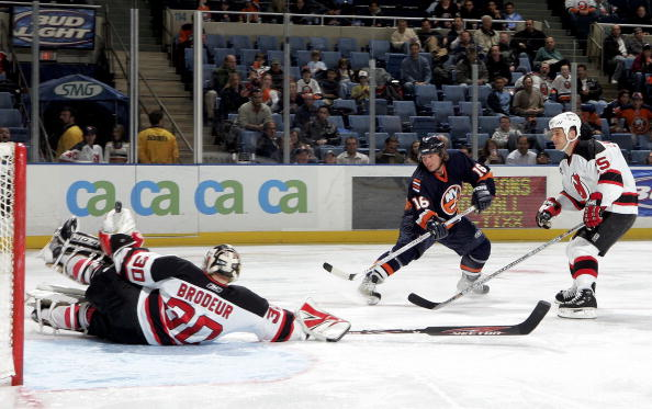 UNIONDALE, NY - MARCH 2:  Martin Brodeur #30 of the New Jersey Devils stops a shot by Mike York #16 of the New York Islanders as Jamie Langenbrunner #15 of the Devils looks on at the Nassau Coliseum on March 2, 2006 in Uniondale, New York. The Isles defeated the Devils 3-2 after a shootout.  (Photo by Jim McIsaac/Getty Images)