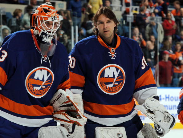 UNIONDALE, NY - APRIL 03:  Dwayne Roloson #30 and Martin Biron #43 of the New York Islanders look on against the Ottawa Senators on April 3, 2010 at Nassau Coliseum in Uniondale, New York. The Isles defeated the Senators 4-1.  (Photo by Jim McIsaac/Getty Images)
