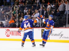 NEW YORK, NY - FEBRUARY 11: Travis Hamonic #3 of the New York Islanders celebrates his goal with Calvin de Haan #44 in the third period against the Los Angeles Kings  during their game at the Barclays Center on February 11, 2016 in New York City.  (Photo by Al Bello/Getty Images)