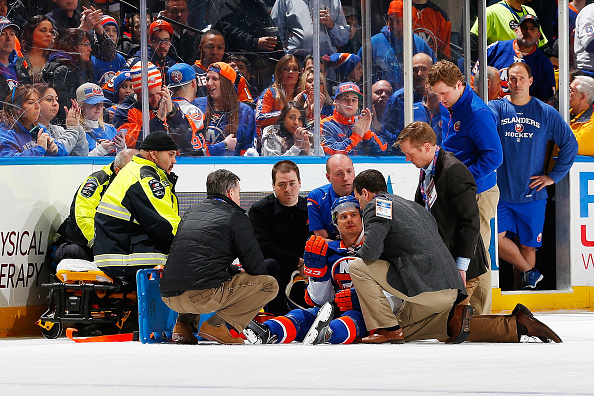 UNIONDALE, NY - FEBRUARY 19: Mikhail Grabovski #84 of the New York Islanders is tended to by medical staff after being checked by Eric Nystrom #24 of the Nashville Predators (not shown) at Nassau Veterans Memorial Coliseum on February 19, 2015 in Uniondale, New York.</p /> </p><!-- google_ad_section_end --></div>     <div class=