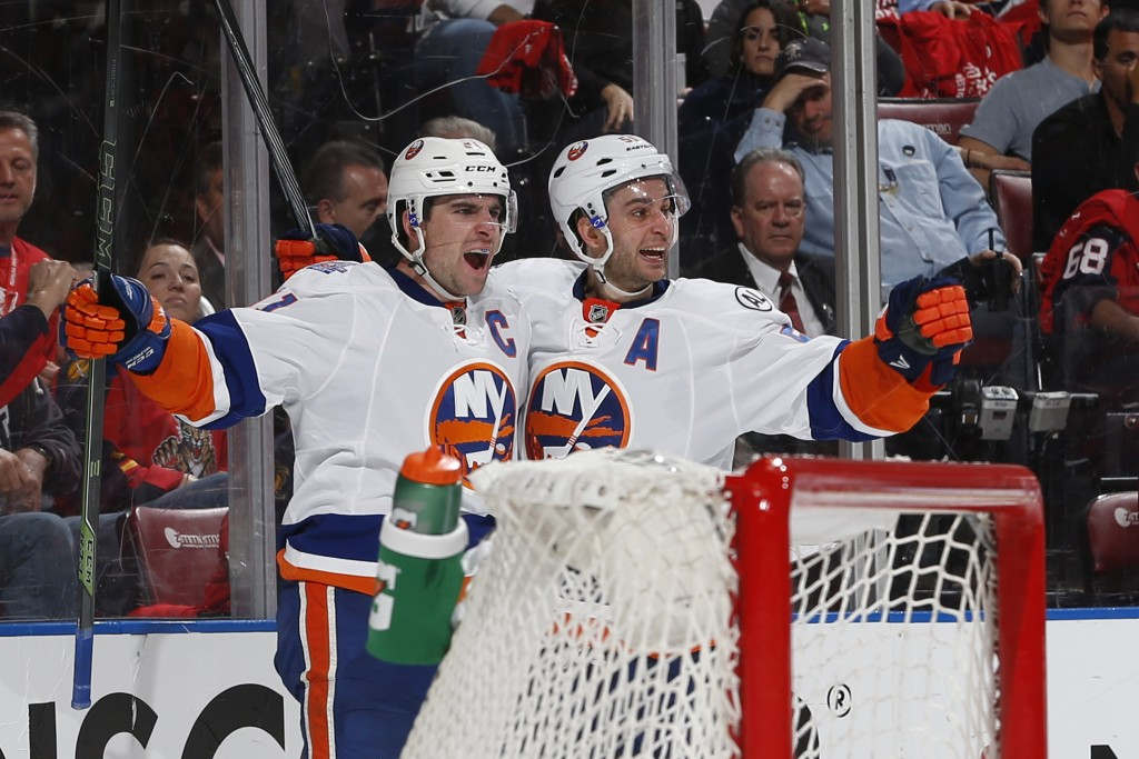 SUNRISE, FL - APRIL 14: John Tavares #91 celebrates his second period goal with Frans Nielsen #51 of the New York Islanders against the Florida Panthers in Game One of the Eastern Conference Quarterfinals during the NHL 2016 Stanley Cup Playoffs at the BB&amp;T Center on April 14, 2016 in Sunrise, Florida.</p /> </p><!-- google_ad_section_end --></div>     <div class=