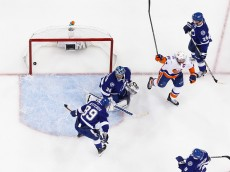 TAMPA, FL - APRIL 27:  John Tavares #91 of the New York Islanders celebrates a goal for his team during the first period against goalie Ben Bishop #30, Nikita Nesterov #89, Matt Carle, and Tyler Johnson #9 of the Tampa Bay Lightning during Game One of the Eastern Conference Second Round in the 2016 NHL Stanley Cup Playoffs at the Amalie Arena on April 27, 2016 in Tampa, Florida.  (Photo by Scott Audette/NHLI via Getty Images)
