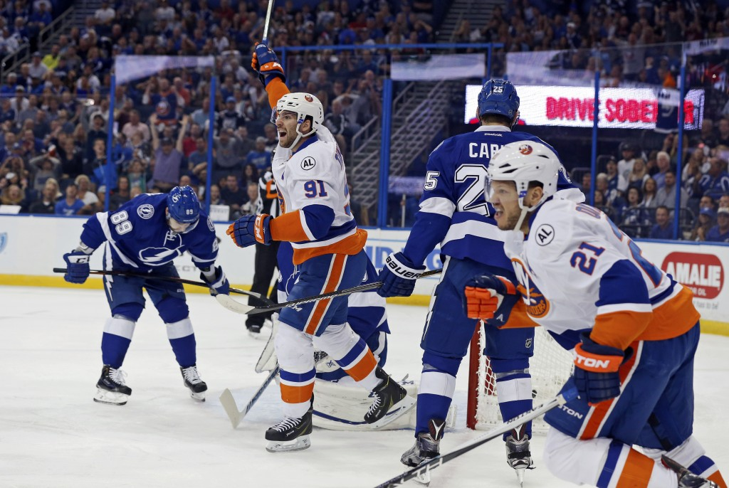 TAMPA, FL - APRIL 27:  John Tavares #91 and Kyle Okposo #21 of the New York Islanders celebrate a goal as Nikita Nesterov #89 of the Tampa Bay Lightning reacts during the first period in Game One of the Eastern Conference Second Round during the 2016 NHL Stanley Cup Playoffs at Amalie Arena on April 27, 2016 in Tampa, Florida. (Photo by Mike Carlson/Getty Images)