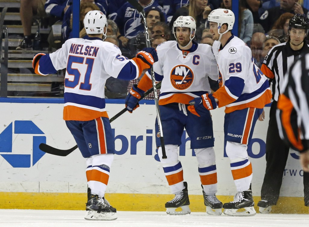 TAMPA, FL - APRIL 27:  John Tavares #91 is congratulated by Frans Nielsen #51 and Brock Nelson #29 of the New York Islanders after his goal against the Tampa Bay Lightning during the second period in Game One of the Eastern Conference Second Round during the 2016 NHL Stanley Cup Playoffs at Amalie Arena on April 27, 2016 in Tampa, Florida.</p /> </p><!-- google_ad_section_end --></div>     <div class=