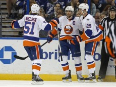 TAMPA, FL - APRIL 27:  John Tavares #91 is congratulated by Frans Nielsen #51 and Brock Nelson #29 of the New York Islanders after his goal against the Tampa Bay Lightning during the second period in Game One of the Eastern Conference Second Round during the 2016 NHL Stanley Cup Playoffs at Amalie Arena on April 27, 2016 in Tampa, Florida. (Photo by Mike Carlson/Getty Images)