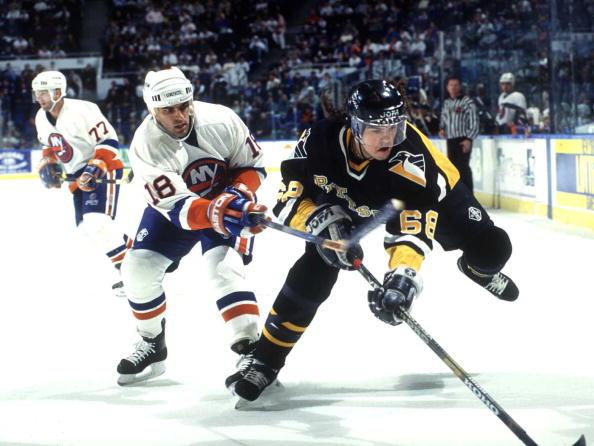 2000 Season: Islanders Marty McInnis trips up Pittsburgh's Jaromir Jagr.  (Photo by Bruce Bennett Studios/Getty Images)