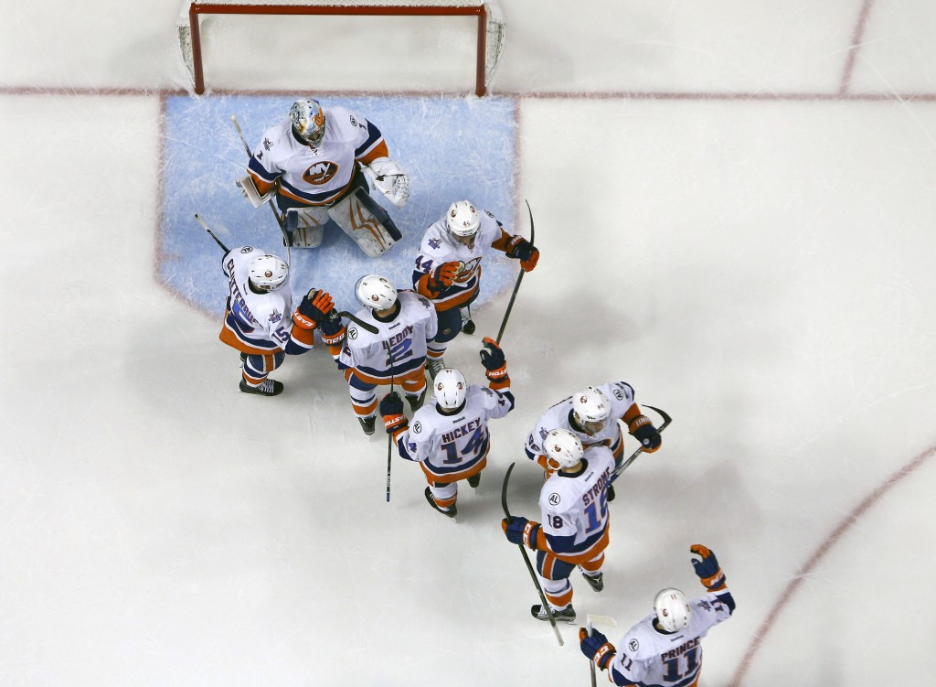 SUNRISE, FL - APRIL 14: Teammates congratulate Goaltender Thomas Greiss #1 of the New York Islanders after the game against the Florida Panthers in Game One of the Eastern Conference Quarterfinals during the NHL 2016 Stanley Cup Playoffs at the BB&amp;T Center on April 14, 2016 in Sunrise, Florida. The Islanders defeated the Panthers 5-4.</p /> </p><!-- google_ad_section_end --></div>     <div class=