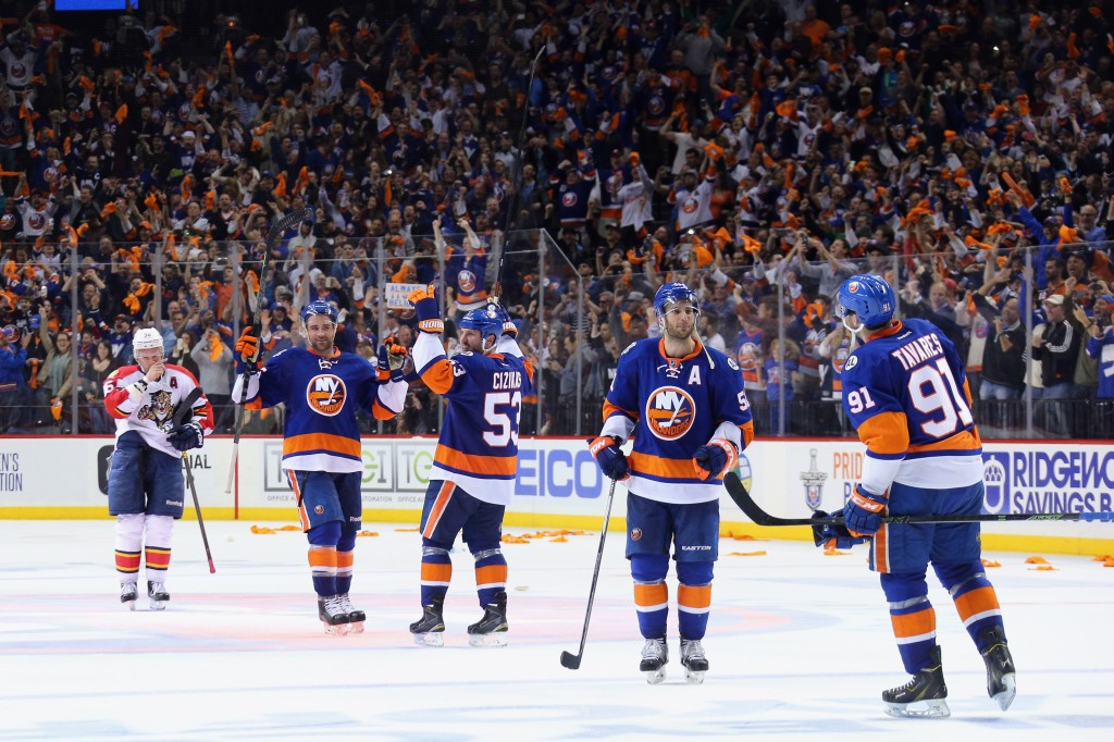 NEW YORK, NY - APRIL 24:  The New York Islanders celebrate a 2-1 victory over the Florida Panthers in Game Six of the Eastern Conference First Round during the 2016 NHL Stanley Cup Playoffs at the Barclays Center on April 24, 2016 in the Brooklyn borough of New York City. The Islanders won the game 2-1 to win the series four games to two.</p /> </p><!-- google_ad_section_end --></div>     <div class=