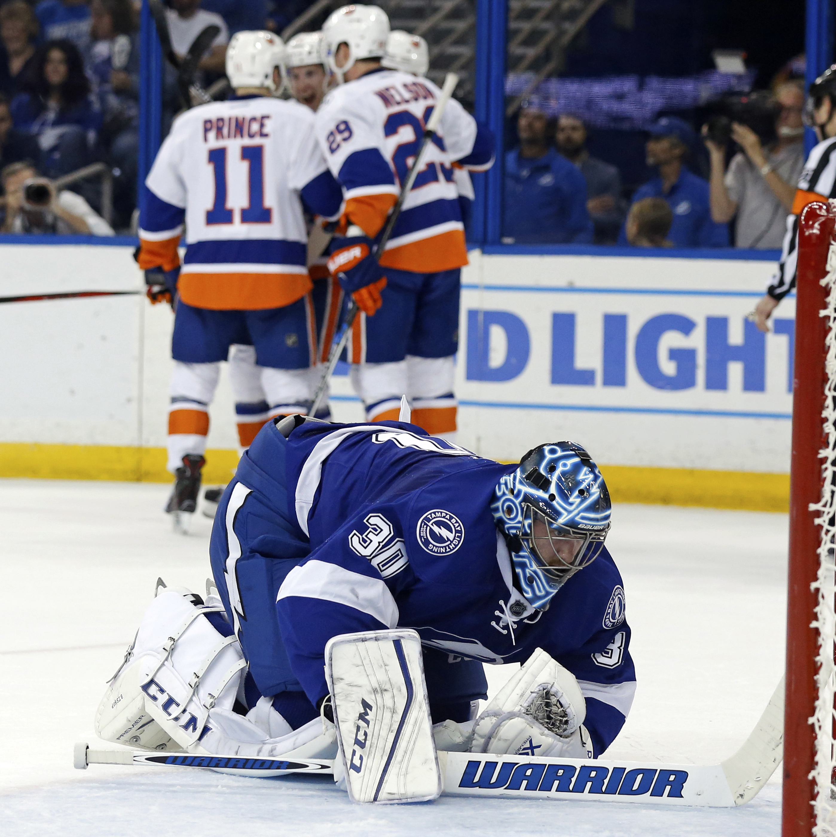 TAMPA, FL - APRIL 27:  Ben Bishop #30 of the Tampa Bay Lightning reacts as members of the New York Islanders celebrate a goal during the first period in Game One of the Eastern Conference Second Round during the 2016 NHL Stanley Cup Playoffs at Amalie Arena on April 27, 2016 in Tampa, Florida. (Photo by Mike Carlson/Getty Images)