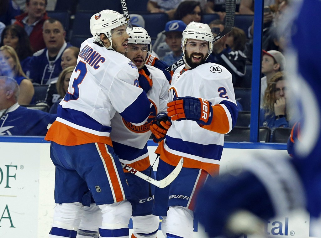 TAMPA, FL - APRIL 27:  Shane Prince #11 of the New York Islanders, center, is congratulated by Travis Hamonic #3 and Nick Leddy #2 after scoring against the Tampa Bay Lightning during the first period in Game One of the Eastern Conference Second Round during the 2016 NHL Stanley Cup Playoffs at Amalie Arena on April 27, 2016 in Tampa, Florida.</p /> </p><!-- google_ad_section_end --></div>     <div class=