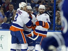TAMPA, FL - APRIL 27:  Shane Prince #11 of the New York Islanders, center, is congratulated by Travis Hamonic #3 and Nick Leddy #2 after scoring against the Tampa Bay Lightning during the first period in Game One of the Eastern Conference Second Round during the 2016 NHL Stanley Cup Playoffs at Amalie Arena on April 27, 2016 in Tampa, Florida. (Photo by Mike Carlson/Getty Images)