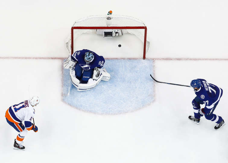 Islanders forward Shane Prince scores against the Tampa Bay Lightning