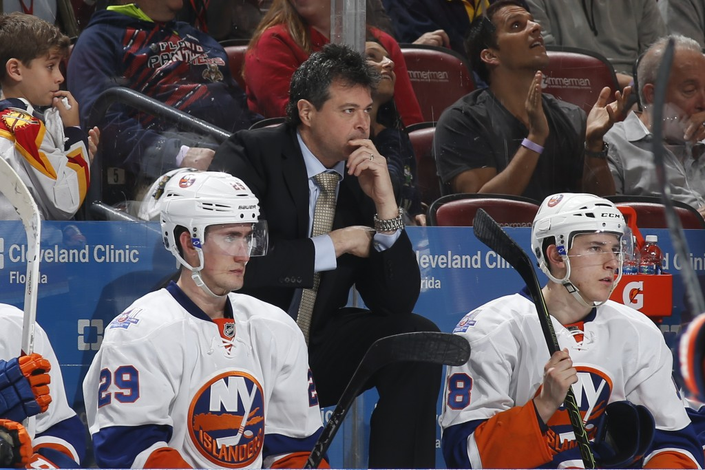SUNRISE, FL - APRIL 15: Head coach Jack Capuano of the New York Islanders looks on as the officials hand out penalties after a fight against the Florida Panthers in Game Two of the Eastern Conference Quarterfinals during the NHL 2016 Stanley Cup Playoffs at the BB&T Center on April 15, 2016 in Sunrise, Florida. The Panthers defeated the Islanders 3-1. (Photo by Joel Auerbach/Getty Images)
