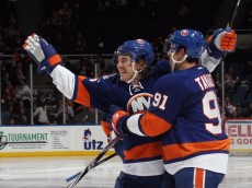UNIONDALE, NY - NOVEMBER 17: P.A. Parenteau #15 of the New York Islanders scores at 41 seconds of the second period against the Montreal Canadiens and is hugged by John Tavares #91 at the Nassau Veterans Memorial Coliseum on November 17, 2011 in Uniondale, New York.  (Photo by Bruce Bennett/Getty Images)